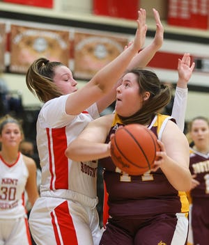 Southeast senior Sarah Need fights for a shot against Kent Roosevelt sophomore Lexie Canning.