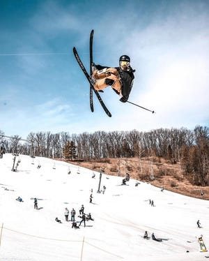 A skier takes to the air at Boston Mills Ski Resort in Summit County last season. Ohio ski resorts are implementing health and safety measures for scheduled openings in late December.