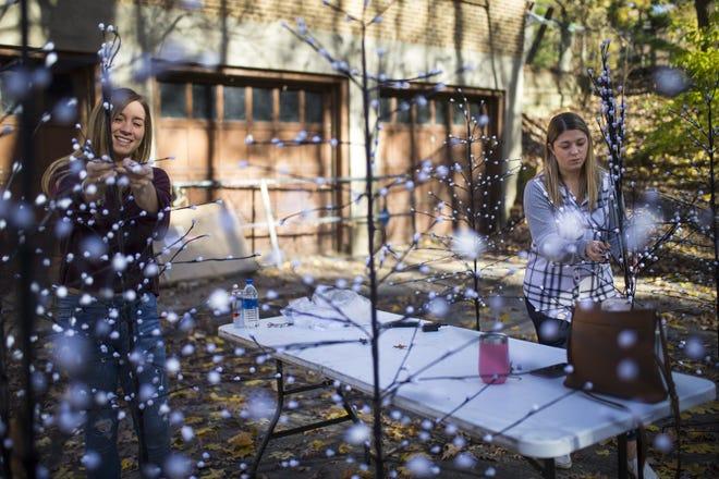 Volunteers Micheyla DiDomenico, left, and Danielle Taylor set up Festival of Lights decorations on Saturday, Nov. 7, 2020, at Sinnissippi Park in Rockford. [SCOTT P. YATES/ROCKFORD REGISTER STAR]