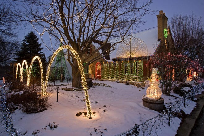 This file photo from 2012, shows a 50,000-light holiday display by Matt Blazer and Jeff Damon on 20th Street in Rockford. This year, ComEd, the city of Rockford and Rockford Area Convention & Visitors Bureau are running #Decorate815, a holiday decorating contest.
