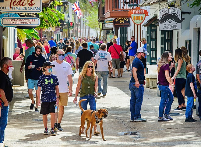 People walk down a crowded St. George Street in St. Augustine on Tuesday, Nov. 24, 2020.