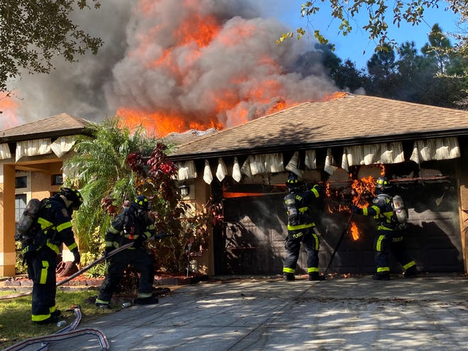 The North Port Fire Department works to extinguish a residential fire in the 5500 block of Abelove Lane in North Port on Tuesday, Nov. 25, 2020.