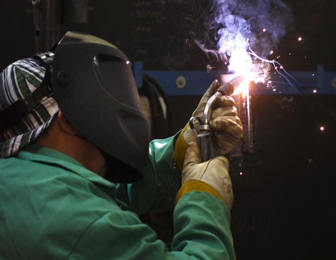 Glenn Mann works on his welding technique during the MIG welding class at Cape Fear Community College's campus in Burgaw, N.C., Tuesday, November 24, 2020. The Burgaw location will be moving into a new facility for the next semester in January.    [MATT BORN/STARNEWS]