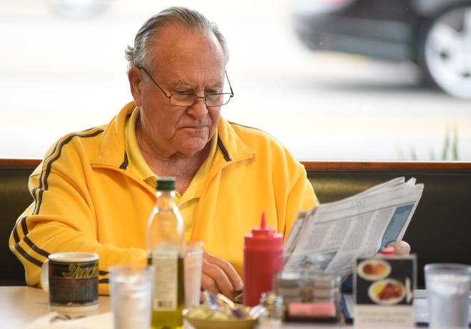 Kit Austin reads the newspaper during lunch at Jimbo's Breakfast & Lunch in Wilmington, N.C., Wednesday, December 6, 2017. The long-time Wilmington establishment celebrating its 40th anniversary.
