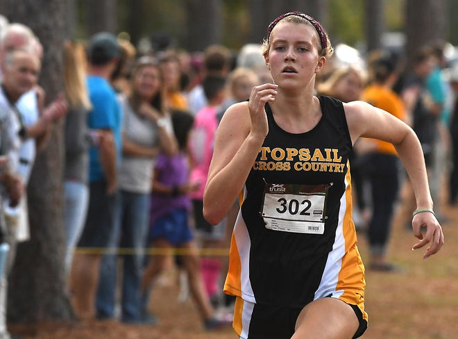 Topsail's Makayla Obremski comes in 2nd place for the girls during the MEC Cross Country Championships Thursday Oct. 24, 2019 at Hugh MacRae Park in Wilmington, N.C.