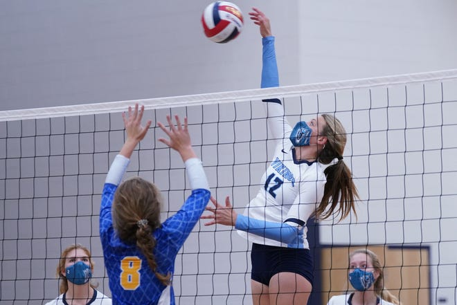 Laney's (8) Brooke Osterhoudt defends as  (12) Gracie Sistrunk shoots at the net as Hoggard hosts Laney for girls volleyball on Tuesday evening.  November 24, 2020.  [KEN OOTS/FOR STARNEWS]