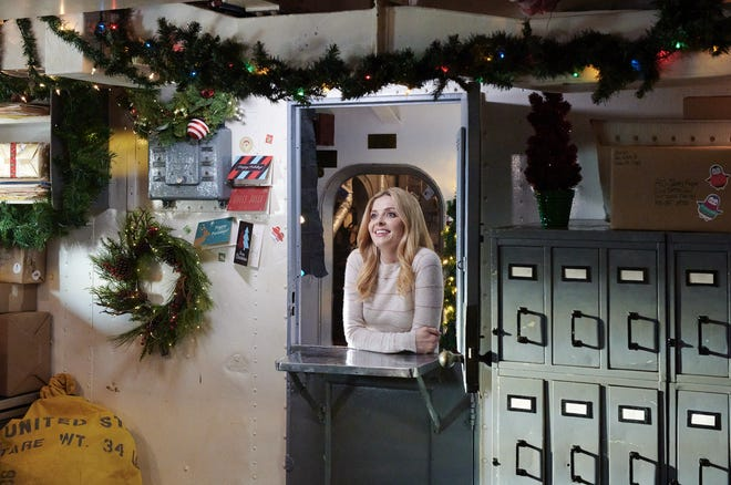 """Jen Lilley, who stars as a reporter after the scoop of a lifetime in Hallmark Movies & Mysteries' """"USS Christmas,"""" filmed this scene onboard the Battleship North Carolina in Wilmington."""