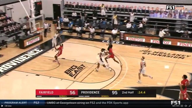 Brycen Goodine goes up for a dunk for Providence College. The New Bedford native made his Friars debut on Wednesday.