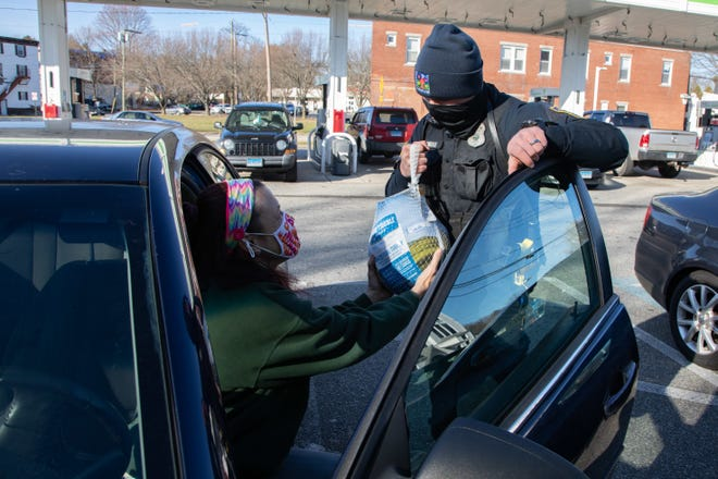 Plainfield police hand out turkeys Tuesday, part of a Thanksgiving community drive that also aided the Project PIN food pantry in Moosup.
