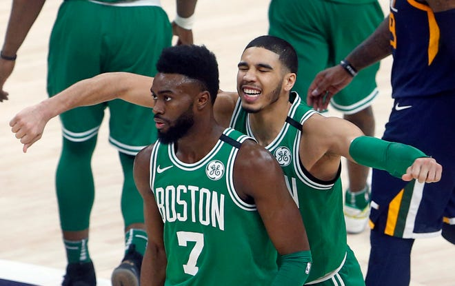 Boston's Jayson Tatum, rear, and Jaylen Brown will lead the Celtics after a short break, as training camp begins Tuesday.