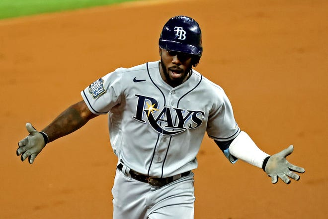 Rays left fielder Randy Arozarena rounds the bases after hitting a home run during the first inning against the Dodgers during Game 6 of the 2020 World Series.
