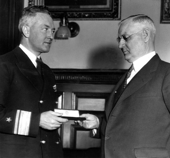 Rear Admiral Richard E. Byrd, U.S.N., retired, left, as he received the key to the city from Worcester Mayor Walter J. Cookson in 1936.