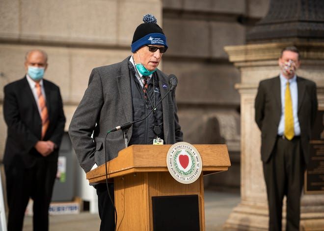 Dr. Michael Hirsh gives an update on behalf of the hospitals during the weekly COVID-19 press conference outside City Hall on Wednesday.