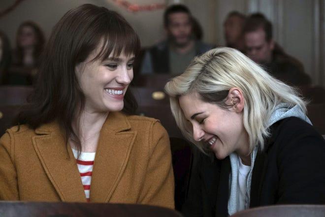 """Mackenzie Davis, left, and Kristen Stewart star in """"Happiest Season."""""""