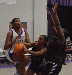 Trinity Christian's Aunyah Teague (10) played a key role in helping the Crusaders slow down DaiJa Turner (24) and Village Christian on Tuesday night.