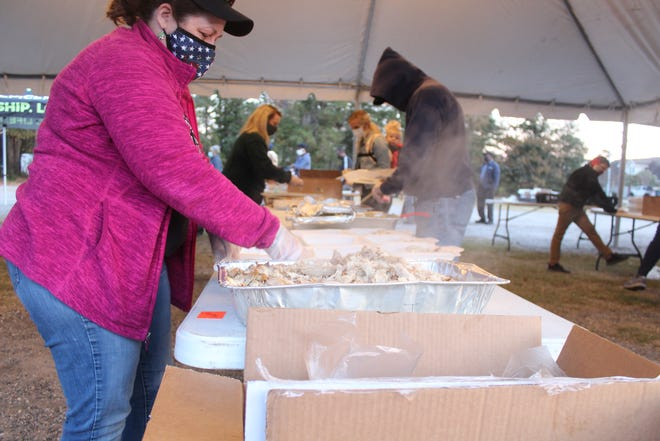 Epicenter Church volunteers put Thanksgiving meals together for families in need on Tuesday night.