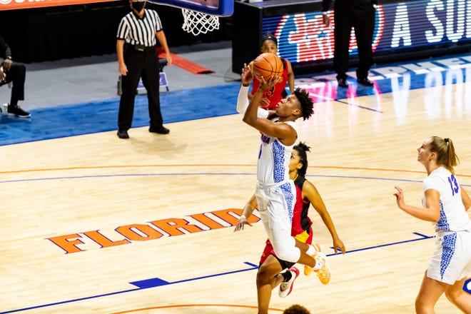 Florida guard Kiara Smith flies in for a layup in the first quarter of the season opener Wednesday against Grambling State at Exactech Arena at O'Connell Center. Smith led the Gators with a game-high 20 points in the 90-47 UF win.