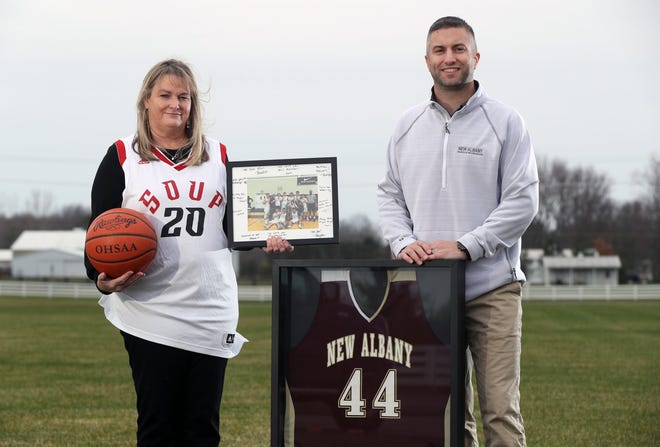 Lindsay Harris of New Albany and Brian Smith, recreation superintendent for New Albany Parks & Recreation, stand with memorabilia from Harris' late son, Michael Lucey, at the site for proposed outdoor basketball courts to be built in his honor outside the public-services facility at Bevelhymer Park in New Albany. Lucey, who was a senior at New Albany High School and played for the Soupreme team in a New Albany recreational basketball league, died in a car crash in August.