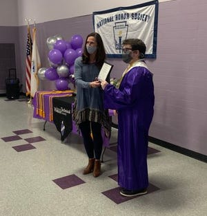 Shawsheen Valley Technical High School English teacher and National Honors Society Advisor Shannon Becker poses for a photo with a student recently induced into the Society.