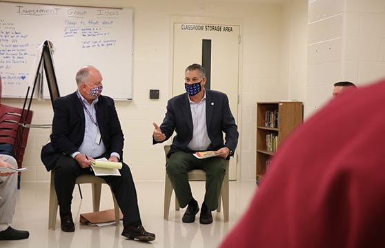 A new initiative aimed at enhancing civic engagement is now underway at the Middlesex Jail and House of Correction. Pictured are Project Citizen facilitator Ed O'Connell, left, and Middlesex Sheriff Peter J. Koutoujian speaking with program participants at the Middlesex Jail and House of Correction.