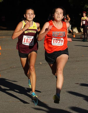 Weymouth High School cross-country team captains Jess Fleming, (left) Kerin Johnson, and Kacie To are credited with leading the Wildcats to a 6-0 season.
