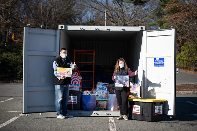 "Wellesley ""elves"" (Recreation Director Matt Chin and Youth Commission Director Maura Renzella) show a few of the toys collected for this year's Wellesley Holiday Toy Drive."
