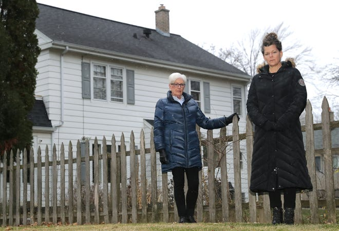 Becky Heldt, right, and her neighbor Marcia Ostwald want Appleton to regulate short-term rentals marketed by companies like Airbnb. The rental property pictured in the background is next door to Heldt's home at 708 S. Summit St.