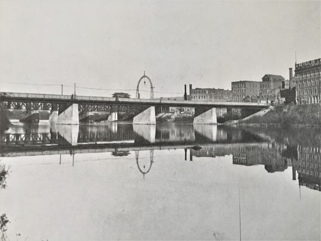A look at the Noyes Comb Co. next to the Ferry Street Bridge (location of current East Clinton Street Bridge), about 1905 .