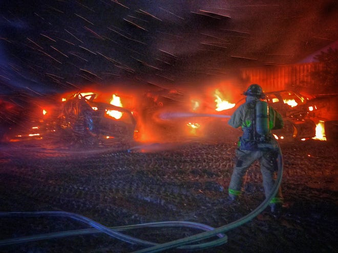Dozens of cars catch fire at recycling plant on Ansin Road near Rockledge Tuesday evening.