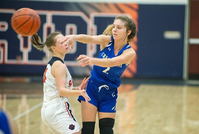 Crestline's Hannah Delong passes the ball around Galion's Dezi Lester.