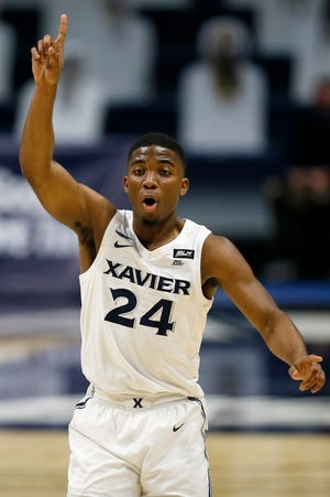Xavier Musketeers guard KyKy Tandy (24) sets up the defense after a basket in the second half of the NCAA basketball game between the Xavier Musketeers and the Oakland Golden Grizzlies at the Cintas Center in Cincinnati on Wednesday, Nov. 25, 2020. Xavier won the season-opening game, 101-49.