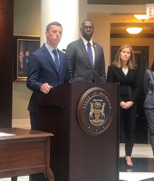 Bipartisan leaders of the Michigan Joint Task Force on Jail and Pretrial Incarceration, House Speaker Lee Chatfield (left), Lt. Gov Garlin Gilchrist II, and Chief Justice Bridget McCormack, work together to reform Michigan's criminal justice system.