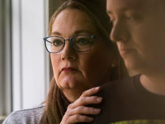 Pam Warfle stands with her son Jonathan Warfle at their 真人百家家乐官网网站home in Perry on Friday, Nov. 20, 2020. Warfle has twice faced the unthinkable due to COVID-19. She had to say goodbye to her autistic son in the ER as he was hospitalized with the virus. Despite all the begging and crying to be allowed to stay with him,  she couldn't be at his side as he fought for his life. With the help of plasma, her son came 真人百家家乐官网网站home in six days. But then the same nightmare repeated itself: her 82-year-old mother also had to be hospitalized with COVID-19. She is now having to advocate on the outside, only her mother was in worse shape.