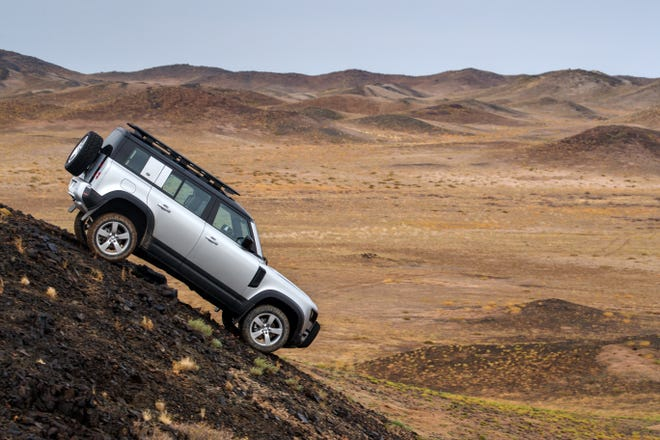 The 2020 Land Rover Defender -- four-door 110 model shown -- can climb a 45 degree slope.