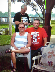 Dennis Wallace, in the red shirt, with his brothers Jamie, seated, and Jeff in the Rotary Park in 2015 in Trenton. Car shows connected family back in the day for the Wallace boys.