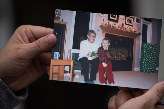 Pam Warfle holds a photo of her mother Leona Smith from 2004.