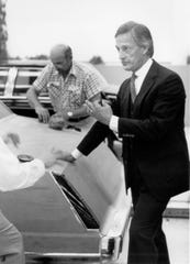 Jack Telnack, a top automotive designer at Ford Motor Co., stands in 1981 with a clay model of a Lincoln in the production studio in Dearborn.