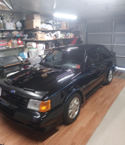 Dennis Wallace of Taylor keeps his 1986 Ford Escort GT in the garage at home. It is a treasured family heirloom driven to car shows and for special occasions.