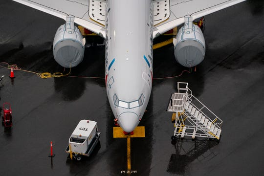 A Boeing 737 MAX airplane sits parked at the company's production facility on Nov. 18 in Renton, Washington. The U.S. Federal Aviation Administration (FAA) cleared the Max for flight after 20 months of grounding. The 737 MAX has been grounded worldwide since March 2019 after two deadly crashes in Indonesia and Ethiopia. (David Ryder/Getty Images)