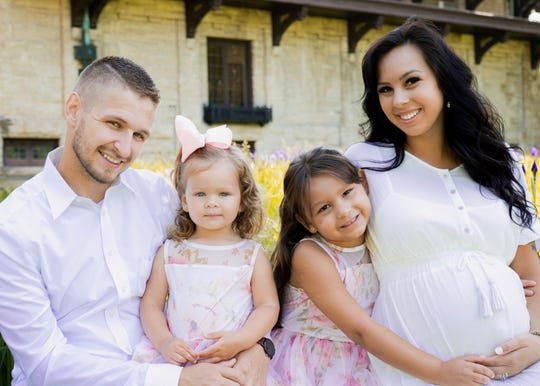 Cody Schuckman with his daughters, Penelope and Piper, and wife, Haley, are pictured in Dearborn in 2019. The family lives in Taylor and Schuckman enjoys fixing cars for friends and family.