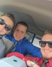 From left, Cody Schuckman, Derick Wallace and Cody's little brother Connor Schuckman in the car in 2016 for their grandfather's funeral in Mount Pleasant. As children, the boys played together in the broken 1986 Ford Escort GT while it sat in a family garage.