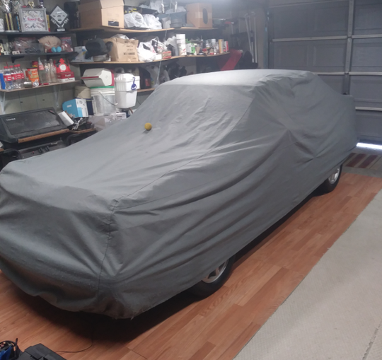 Dennis Wallace keeps his beloved 1986 Ford Escort GT covered in his garage at home in Taylor when he's not taking it to car shows. The car is a treasured memory capsule for the family.