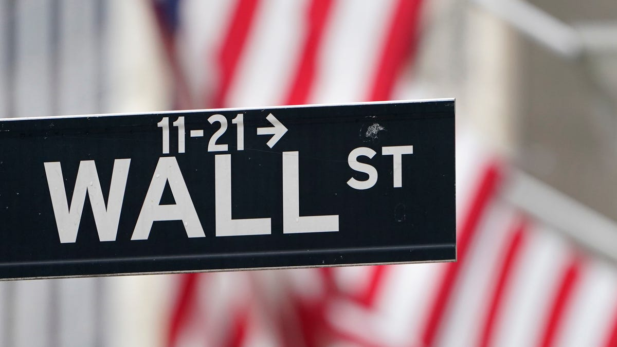 Stocks move mostly lower even as Nasdaq edges...