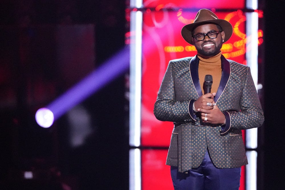 John Holiday s momentum on  The Voice  continues, as the Appleton singer advances to live playoffs