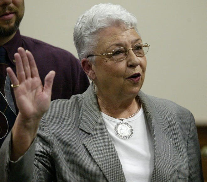 This 2004 photo shows Sadie Holland taking the oath of office for Justice Court Judge at the Lee County Justice Center in Tupelo, Miss.
