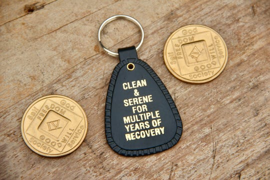 The Henry's keep all of their recovery milestones, such as these Narcotics Anonymous coins and key tag.