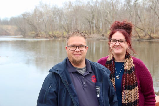 Dock, left, and Lori Henry stand in front of the Tippecanoe River near their Monticello home.