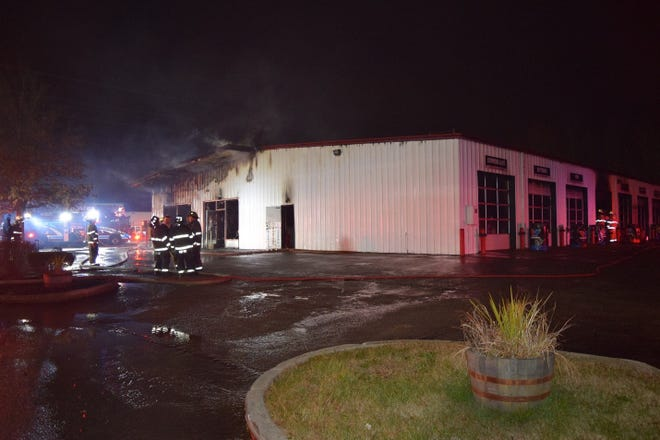 "Big O Tires and Auto Service Center on Outer Loop was ""severely damaged"" after someone set fire to the structure Tuesday morning, officials say."