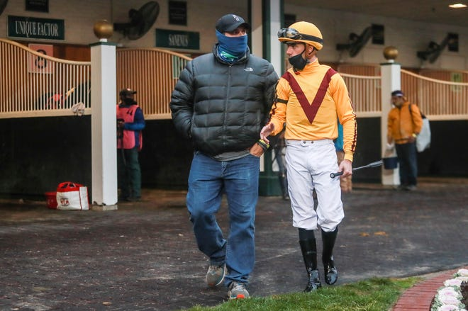 Trainer Brad Cox talks with jockey Florent Geroux before the ninth race on a recent Saturday during the Fall Meet at Churchill Downs. Cox, a Louisville native, ranked 4th in both wins and earnings in 2019. Cox's career earnings since 2004 are more than $76 million. Nov. 21, 20020
