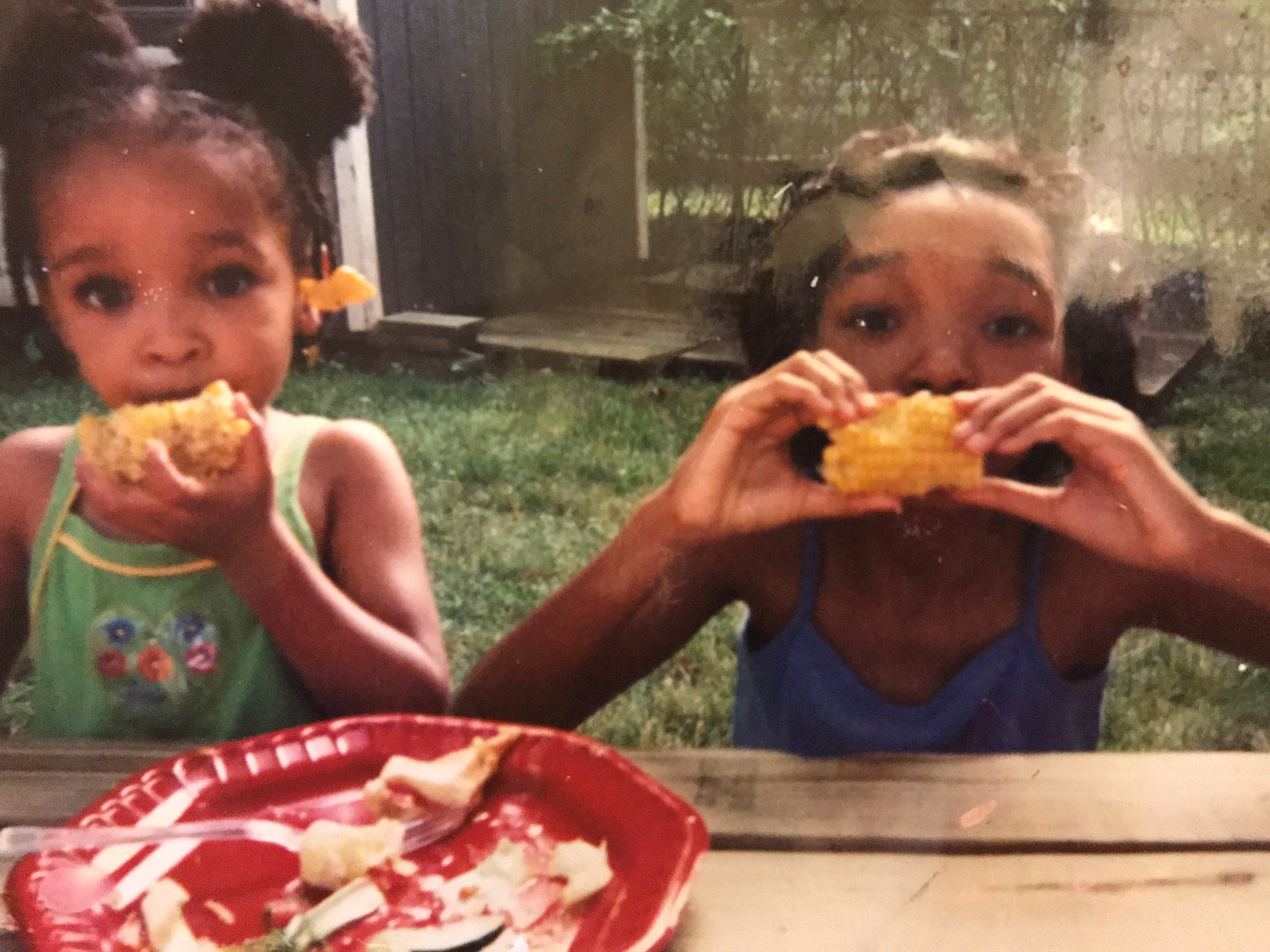 Shaylah Brown and her younger sister on a summer afternoon enjoying corn on the cob in 2003.